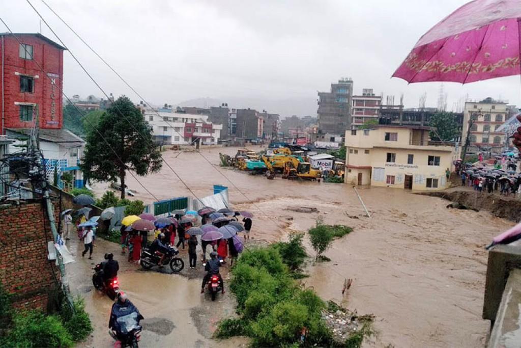 Locals observe flooded river in Kalanki, on Friday, July 12, 2019. Courtesy: Bikash Adhikari